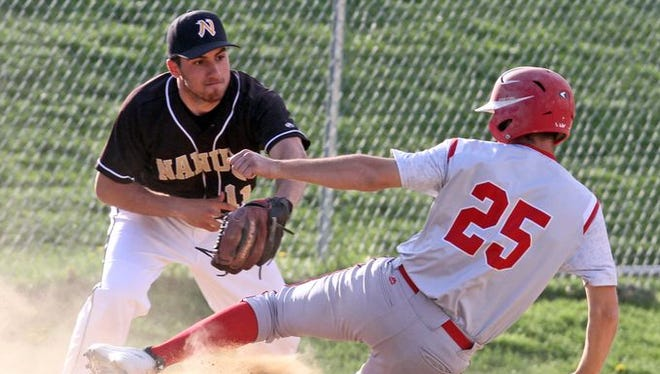 Tappan Zee's Bryan Borruso is tagged out by Nanuet third baseman Jaan Dar after an rbi fly ball out to left field in the sixth inning of a varsity baseball game at Tappan Zee High School. Nanuet defeated Tappan Zee 3-1.