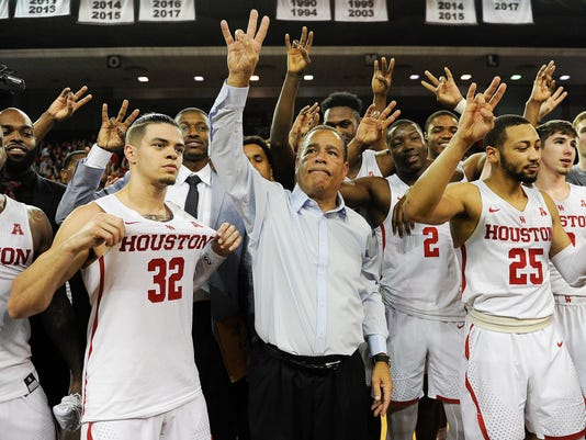 Houston head coach Kelvin Sampson, center, celebrates with his team Houston's 73-59 win over Wichita State in an NCAA college basketball game, Saturday, Jan. 20, 2018, in Houston. (AP Photo/Eric Christian Smith)