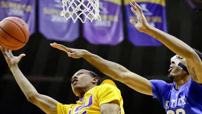 LSU guard Tim Quarterman (55) shoots over Kentucky forward Marcus Lee (00) during Tuesday's game at the Pete Maravich Assembly Center in Baton Rouge.