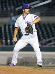 Dillon Maples throws a pitch for the Iowa Cubs.