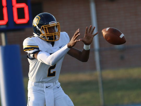 Moeller's Miles McBride threw four TD passes in the