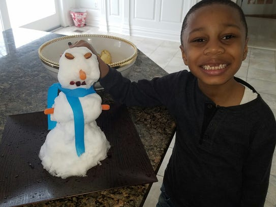 Snow Much Fun... Avaery Sajous of Watchung, a first-grade