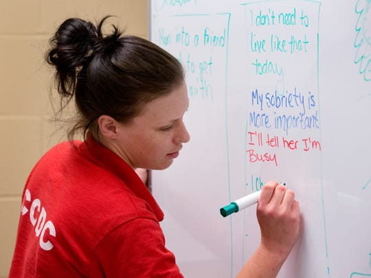 Destinee Anton, 27, takes part in a Behavior Chain class in the Chemical Dependency Program.