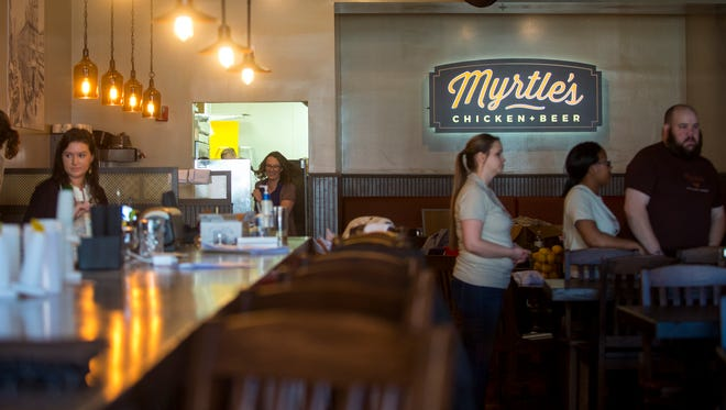 Employees work on the finishing touches at Myrtle's Chicken & Beer, a new restaurant in downtown Knoxville's Market Square, on March 9, 2018.