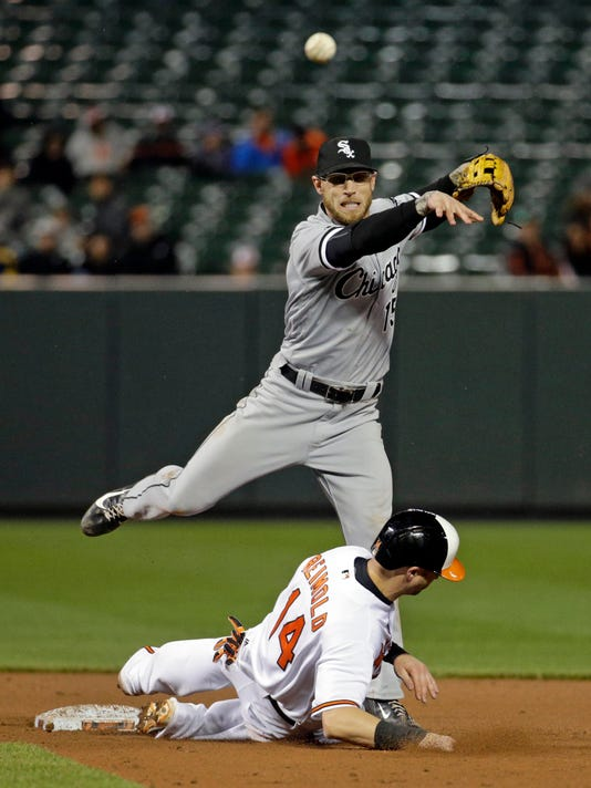 Chicago White Sox second baseman Brett Lawrie, top, tries but cannot turn a double play after forcing out Baltimore Orioles' Nolan Reimold on a single by Jonathan Schoop in the seventh inning of a baseball game in Baltimore, Thursday, April 28, 2016. Baltimore won 10-2. (AP Photo/Patrick Semansky)