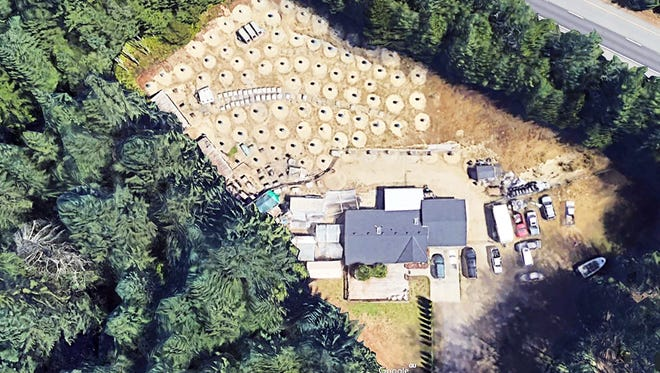 The San Nicolas property in Port Orchard, Washington, shown in this 3D Google Earth image, drew complaints from neighbors for years. On June 2, state Gambling Commission agents arrested two men and seized 300 roosters at the property.