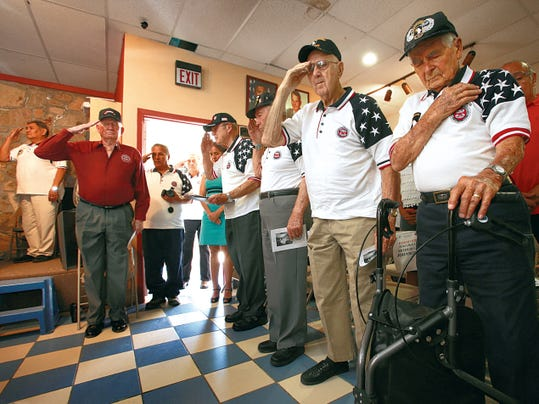"""VICTOR CALZADA-EL PASO TIMES World War II veterans saluted as they remembered the fallen Friday at the annual D-Day remembrance ceremony at the Benavidez-Patterson """"All Airborne"""" Chapter of the 82nd Airborne Division Association. About 20 World War II veterans who were present were honored as well as about 30 additional who have passed away. Among those present were D-Day paratroopers (from right) pathfinder Maynard L. """"Beamy"""" Beamesderfer, Maj. (retired) Arthur L. Johnson and Lt. Col. (retired) Robert E. """"Bob"""" Chisolm."""