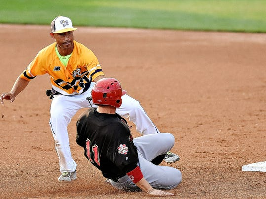 York's Wilson Valdez, left, tags out Lancaster's Luke Hughes at second base during Atlantic League action at Santander Stadium in York on Wednesday. Lancaster won the game in 10 innings, 4-3.