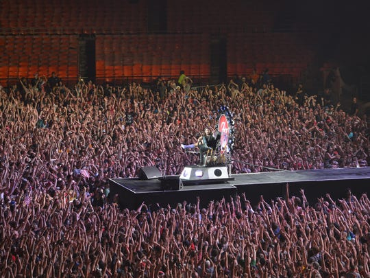 The crowd reacts as Dave Grohl, lead singer of the