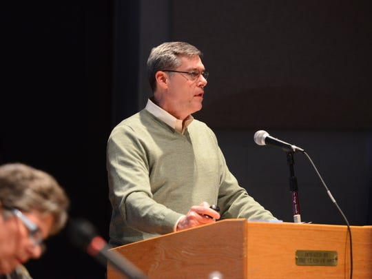 Williston Selectboard member Ted Kenney explains why he supports a change to the town's pet attack law during a meeting Monday night at Williston Central School. Residents approved the measure.
