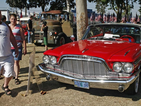 Car enthusiasts walk among the vintage autos on display in the classic car show on the ninth day of the Oregon State Fair on Sunday.