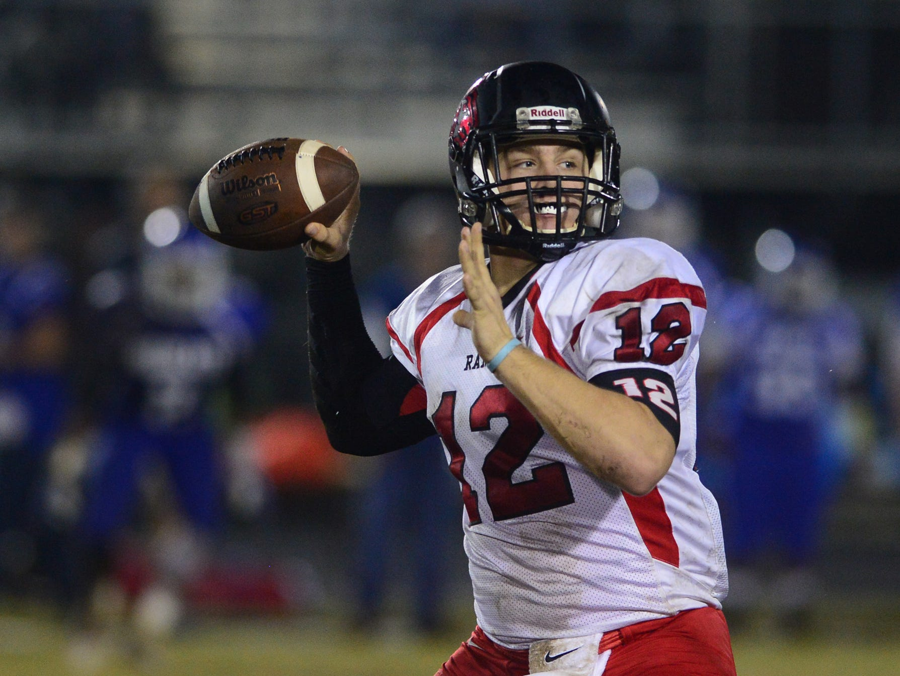 Hillcrest High quarterback Collin Sneed (12) looks to make a pass during a game against Woodmont High School on Friday.