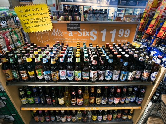 Giant sells six-packs of beer at its store on East Market Street in Springettsbury Township. Shoppers can create their own six-pack from the wide assortment of beer the store offers.
