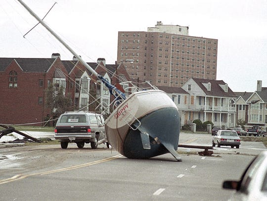 A sailboat lies in a Charleston street on Sept. 22,