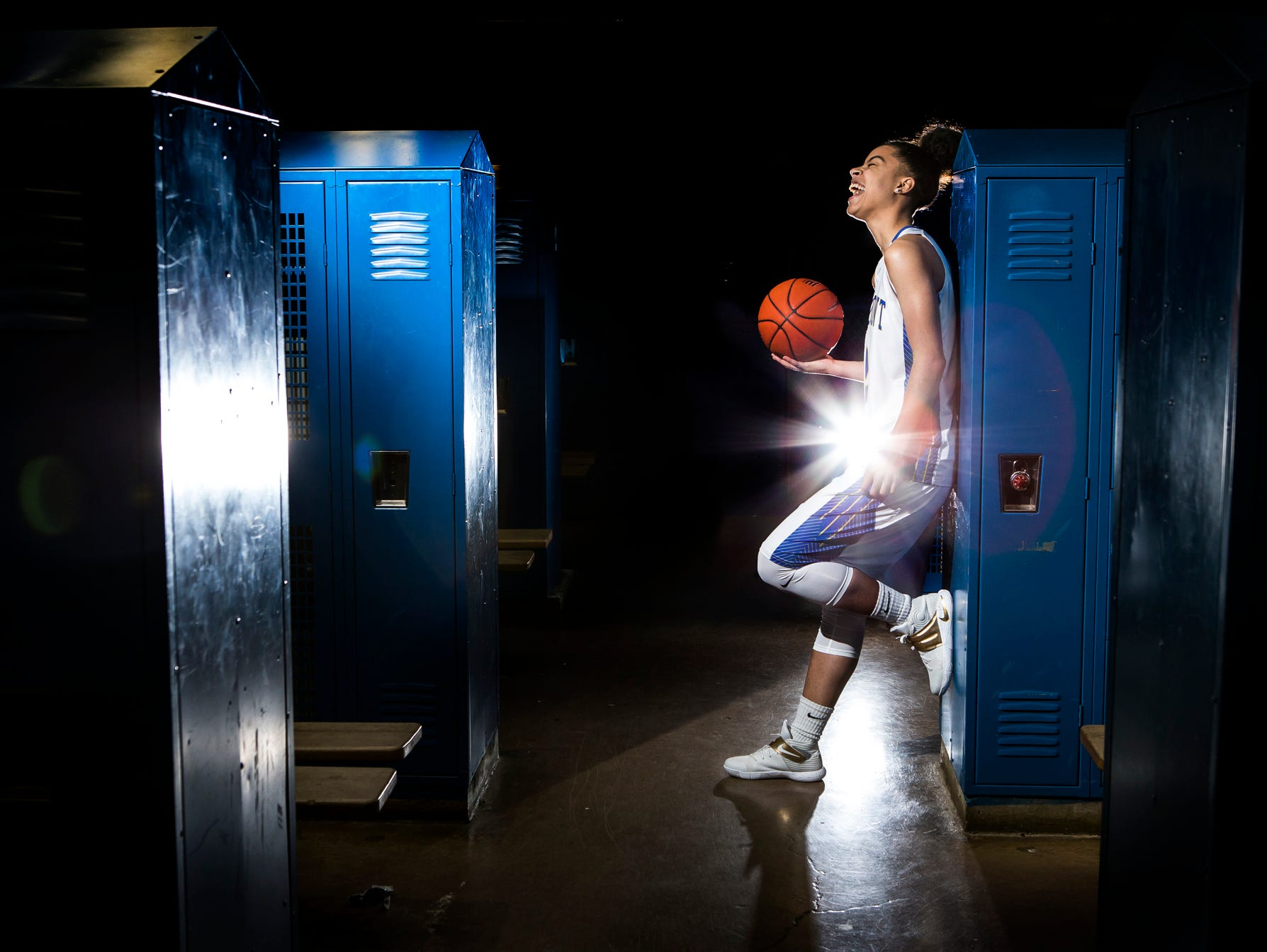 A.I. duPont's Lauryn Griffin laughs as she poses for a portrait int the locker room at A.I. duPont High School in Greenville on Monday afternoon.