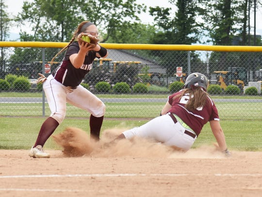 Shippensburg's Courtney Coy (left) tags out Mechanicsburg's
