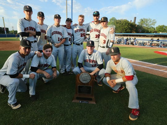 The Stewarts Creek baseball team poses with the Runner-up trophy after losing to Brentwood in the Class AAA Baseball State Championship game.