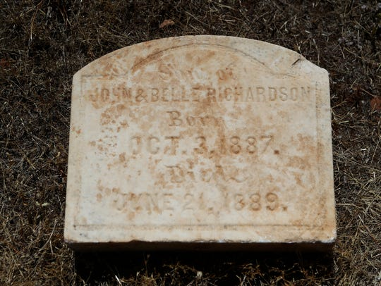 The front of the headstone recently returned to a historical