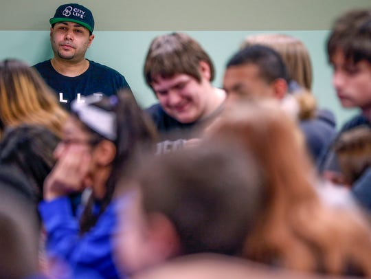 Danny Marquez listens as teens discuss their troubles