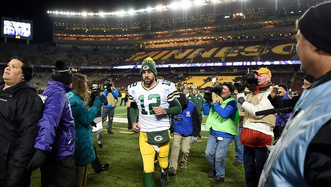 Green Bay Packers quarterback Aaron Rodgers runs off the field after Sunday's game at TCF Bank Stadium in Minneapolis, Minn. The Packers defeated the Vikings 30-13.