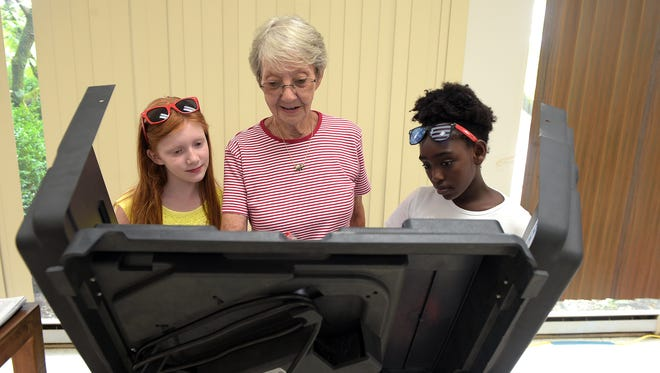 Franklin resident Paula McCord, center, takes her granddaughter Zoe McCord, 9, right, and her friend Reagan Sheridan, 9, to the first day of early voting at the Williamson County complex in Franklin on July 15, 2016.