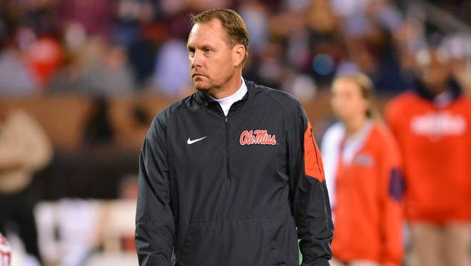 Coach Hugh Freeze walks through warm ups before the game against the Mississippi State Bulldogs at Davis Wade Stadium Mississippi won 38-27.. Mandatory Credit: Matt Bush-USA TODAY Sports