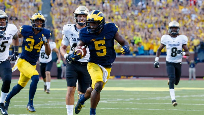 Michigan Wolverines linebacker Jabrill Peppers runs the ball in the second half against the Colorado Buffaloes at Michigan Stadium. Michigan won 45-28.
