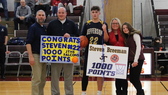 Jefferson senior Steve Breeman celebrates his 1,000th career point with parents Steve and Colleen Breeman and sister Victoria Breeman, and head coach Joe DiGennaro.