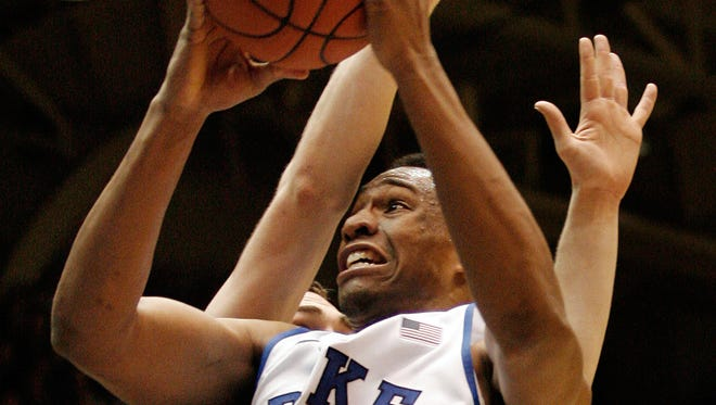 Duke Blue Devils forward Jabari Parker drives against Wake Forest Demon Deacons forward Tyler Cavanaugh at Cameron Indoor Stadium.