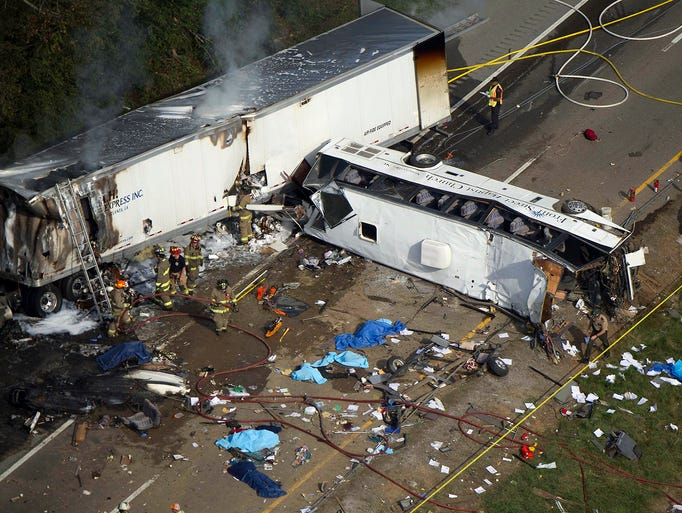 Emergency personnel work at the scene of a crash involving a passenger bus and a tractor-trailer on Oct. 2 near Dandridge, Tenn. Eight people were killed in a fiery wreck when a bus carrying a church group from North Carolina veered across a highway median and crashed into a sport-utility vehicle and a tractor-trailer.