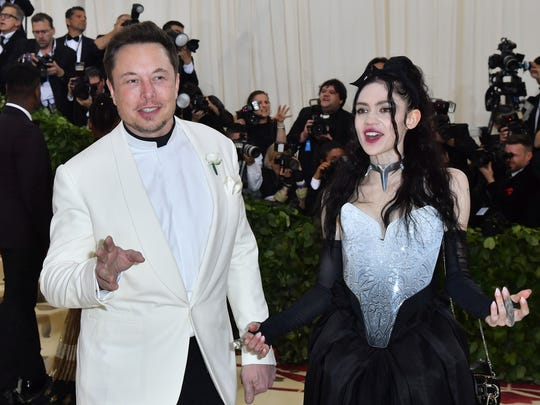 Elon Musk and Grimes arrive for the 2018 Met Gala on May 7, 2018, at the Metropolitan Museum of Art in New York. The Gala raises money for the Metropolitan Museum of Arts Costume Institute. The Gala's 2018 theme is Heavenly Bodies: Fashion and the Catholic Imagination. / AFP PHOTO / ANGELA WEISSANGELA WEISS/AFP/Getty Images ORG XMIT: 1 ORIG FILE ID: AFP_14M9E3
