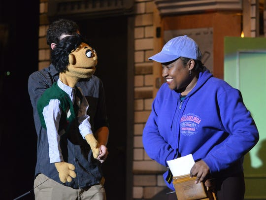 Sam Balzac and the puppet Princeton, left, talk to