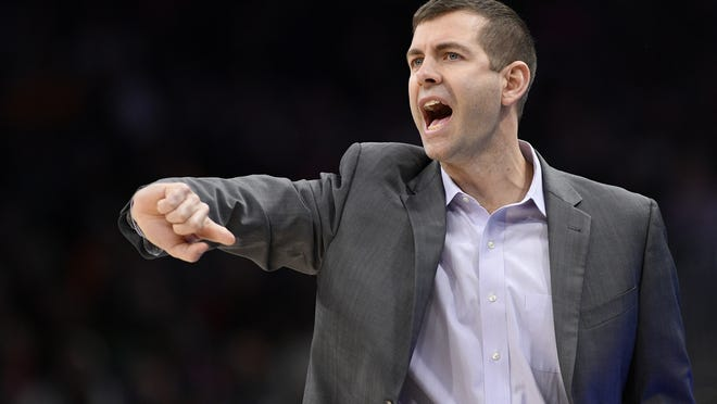 Boston Celtics head coach Brad Stevens gestures during the second half of a January game against the Washington Wizards in Washington. Before the pandemic forced the NBA to pause its season, the Celtics were a team eager to figure out what they could be. That question still lingers as Boston prepares to restart the now-truncated season inside the Orlando bubble.