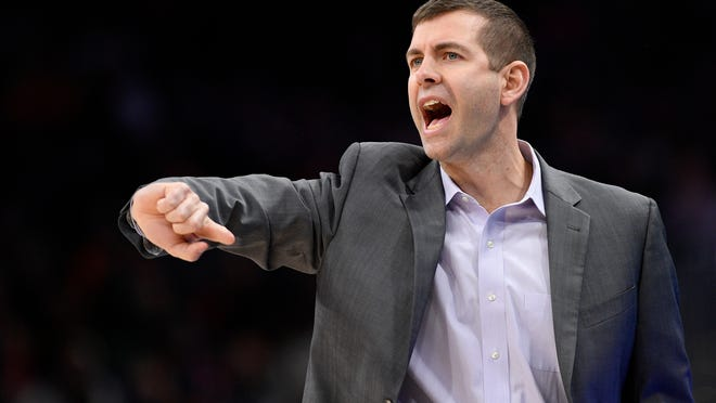 FILE - In this Jan. 6, 2020 file photo, Boston Celtics head coach Brad Stevens gestures during the second half of an NBA basketball game against the Washington Wizards in Washington. Before the pandemic forced the NBA to pause its season, the Celtics were a team eager to figure out what they could be. That question still lingers as Boston prepares to restart the now-truncated season inside the Orlando bubble.