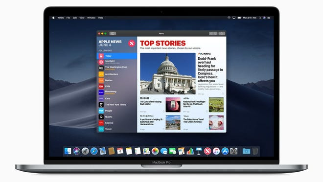 Apple News interface displayed on a MacBook
