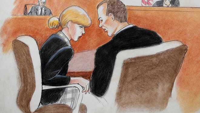 A courtroom sketch of Taylor Swift with her attorney as David Mueller, and the judge look on during a civil trial in federal court Aug. 8, 2017, in Denver.