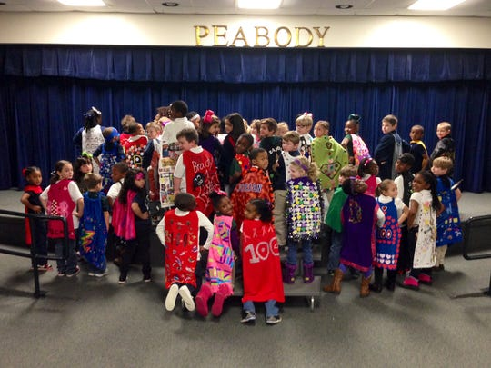 Peabody Montessori Elementary School first- and second-graders celebrated the 100th day of school on Friday with capes featuring 100 items of their choosing. Student re-purposed shirts and pillowcases and decorated them with anything from their thumbprints to 100 candy wrappers.
