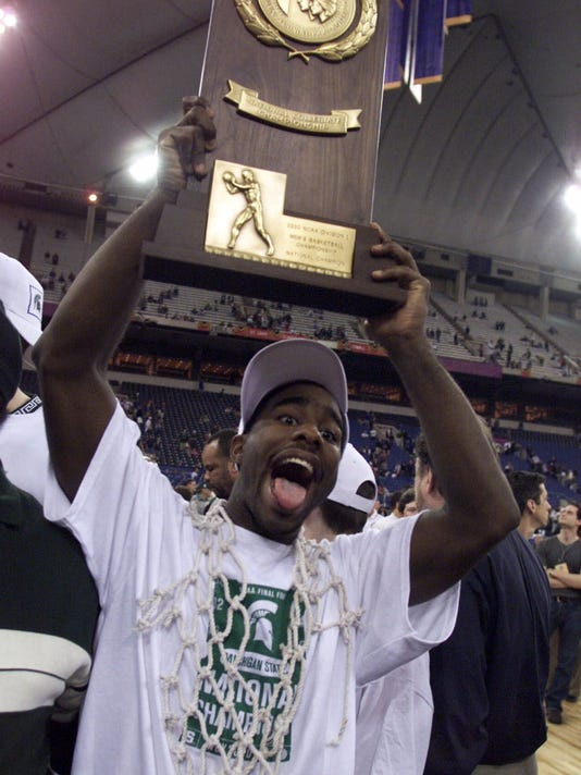 "FILE - In this April 3, 2000, file photo, Michigan State's Mateen Cleaves celebrates with the trophy after Michigan State beat Florida 89-76 for the NCAA Championship at the RCA Dome in Indianapolis. Some of the most intense, pressure-packed moments of the NCAA Tournament's final night often come in a video production truck as CBS Sports producers rush to finish the ""One Shining Moment"" montage, the highlight reel set to a sappy tune that celebrates its 30th anniversary of closing March Madness on Monday night, April 3, 2017. (AP Photo/Michael Conroy, File)"
