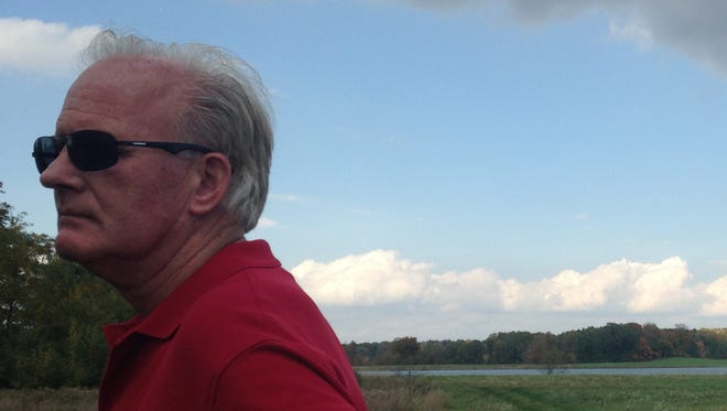 Randy Crandell at his family's property, located off M-50 just outside of Charlotte. A sale of the 432-acre former gravel pit to Eaton County will be finalized within the next few months and the property is slated to become the county's largest park.