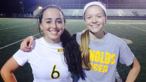Reynolds' Karissa Grooms, left and Megan McCallister.