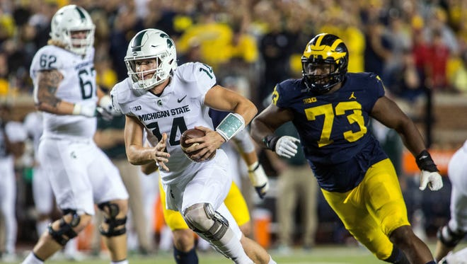 Oct. 7: Brian Lewerke rushes past Michigan defensive lineman Maurice Hurst for a 14-yard touchdown in the first quarter, giving the Spartans a 7-3 lead.