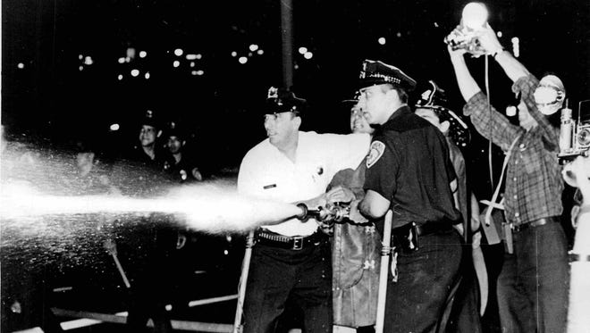 Police in action during the July 1964 riots.