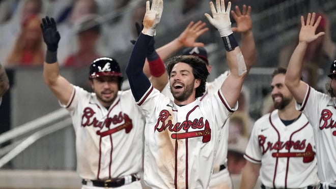 Atlanta Braves shortstop Dansby Swanson, center, celebrates after hitting a walk-off two-run home run in the ninth inning of a baseball game against the Washington Nationals on Monday.