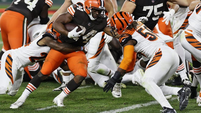 Cleveland Browns running back Nick Chubb fights through Cincinnati defenders for a 1-yard touchdown during the teams' matchup in September. Now healthy, Chubb had missed the last four games due to a knee injury.
