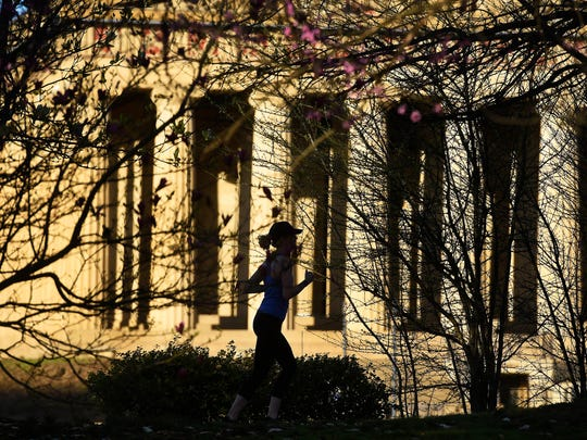 A runner pass by the Parthenon at Centennial Park as spring is just around the corner March 16, 2016 in Nashville, Tenn.