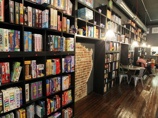 Shelves of board games cover the wall inside Rook,