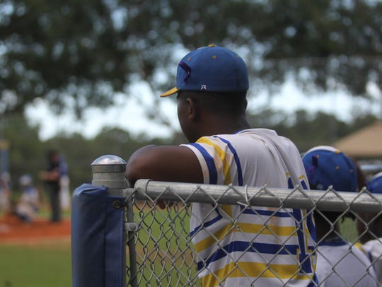 Rickards wore purple ribbons on their hats during Friday's