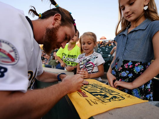 York Revolution pitcher Beau Vaughan signs a rally towel for fans in 2014. Vaughan, one of the most reliable relievers in club history, will return for the Revs in 2016.