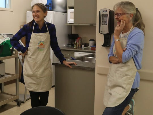 Patient educator Betsy Amstutz, left, and her youth cooking class assistant, nurse Jayne Cummins, enjoy watching their students prepare a meal Thursday at Shasta Community Health Center in Redding.