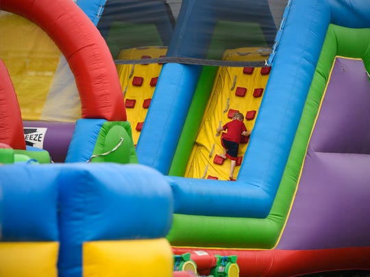 Bounce rides are popular attractions June 9, 2018 at the Libertyville block party as part of Sartell Summerfest celebrations.